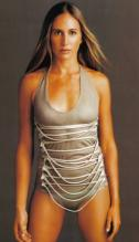 Gisela Dulko in a tight silver outfit model shot.jpg