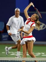 Gisela Dulko jumps up to hit an overhead in a mixed doubles match.jpg