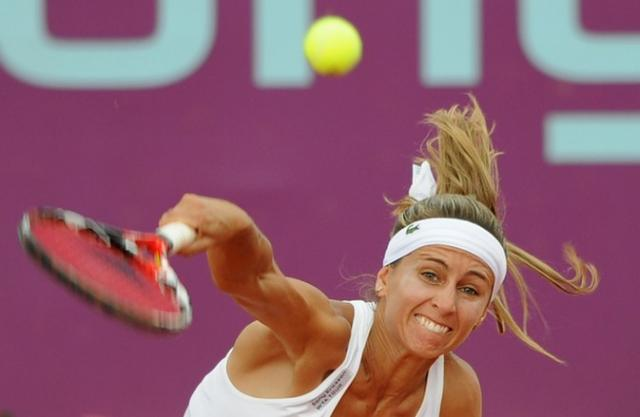 Gisela Dulko serve follow through.jpg