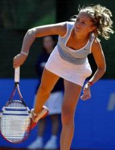 Gisela Dulko serve follow through 2.jpg