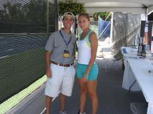 Gisela Dulko takes a picture with a fan.jpg
