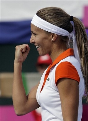 Gisela Dulko celebrates with a fist pump.jpg