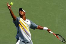 donald young serve ball toss.jpg