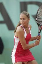 Gisela Dulko gears up to hit a two handed backhand.jpg