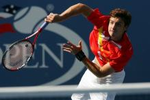 ernests gulbis serve follow through.jpg