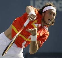 juan monaco serve follow-through.jpg