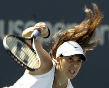 marion bartoli serve follow-through 3.jpg