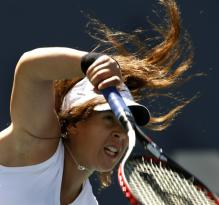 marion bartoli serve follow-through.jpg