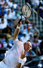 nikolay davydenko serve follow-through.jpg