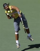 rafael nadal serve follow-through 5.jpg