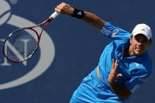 stanislas wawrinka serve follow through.jpg