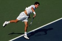 tim henman serve follow-through.jpg